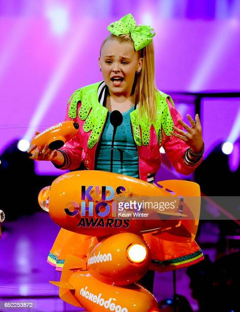 Singer JoJo Siwa accepts the award for Favorite Viral Music Artist onstage at Nickelodeon's 2017 Kids' Choice Awards at USC Galen Center on March 11...