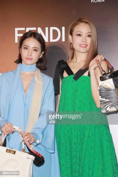Singer Jolin Tsai and singer Joey Yung attend the opening banquet of Fendi Peekaboo Project on October 19 2017 in Hong Kong China
