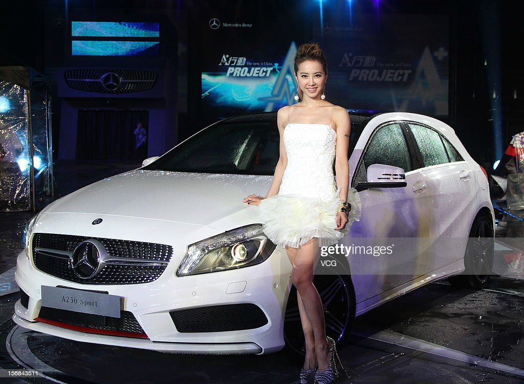 Singer Jolin Tsai poses with a Mercedes-Benz A 250 Sport car during a Mercedes-Benz promotional event at the Chiang Kai-shek Memorial Hall on November 22, 2012 in Taipei, Taiwan.