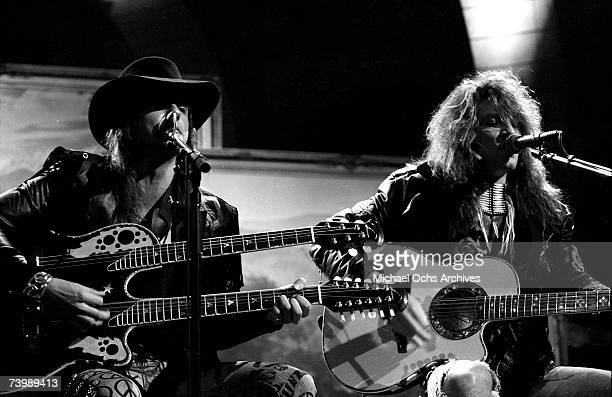 Singer Jon Bon Jovi and guitarist Richie Sambora of the hard rock group Bon Jovi play acoustic guitar as they performs their hit song Wanted Dead Or...