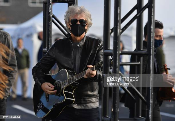 Singer Jon Bon Jovi arrives on stage to perform during a Biden-Harris Drive-In rally at Dallas High School, in Dallas, Pennsylvania, on October 24,...