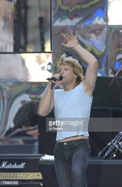 Singer Jon Bon Jovi of the hard rock group Bon Jovi performs onstage during NFL Kickoff Weekend in Times Square on September 5 2002 in New York City...