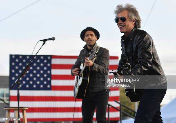 Singer Jon Bon Jovi performs during a Biden-Harris Drive-In rally at Dallas High School, in Dallas, Pennsylvania, on October 24, 2020.