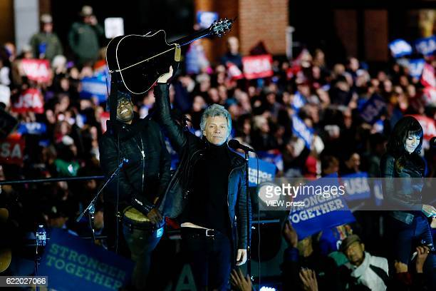 S Singer Jon Bon Jovi performs to supporters while they wait the arrival of Democratic presidential nominee Hillary Clinton US President Barack Obama...