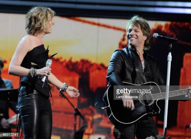 Singer Jon Bon Jovi performs with Jennifer Nettles of Sugarland onstage during the 52nd Annual GRAMMY Awards held at Staples Center on January 31...