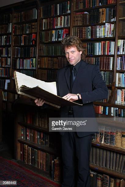 Singer Jon Bon Jovi poses for photos in a library at the Oxford Union Oxford England on June 15 2001 The star took time out of his tour to speak at...