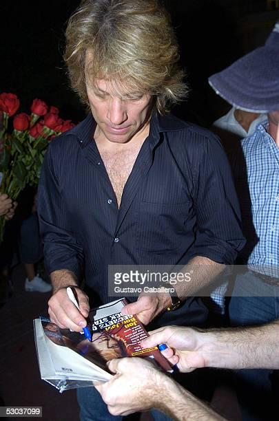 Singer Jon Bon Jovi signs an autograph as he arrives at Metro Lounge June 8 2005 in Miami Beach Florida