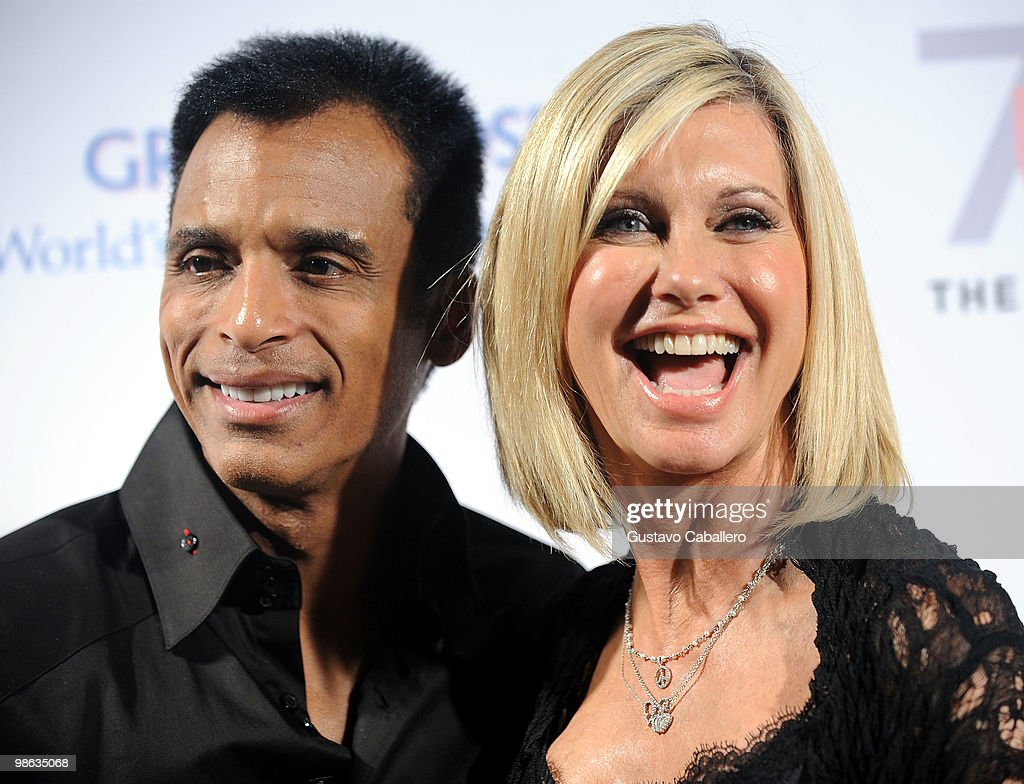 Pink and blue for two event photos and images getty images singer jon secada and olivia newton john attends the pink and blue for two m4hsunfo