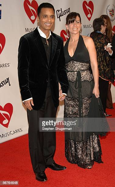Singer Jon Secada and wife Maritere Vilar arrive at the 2006 MusiCares Person of the Year honoring James Taylor at the Los Angeles Convention Center...