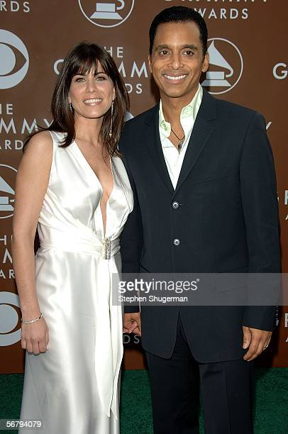 Singer Jon Secada and wife Maritere Vilar arrive at the 48th Annual Grammy Awards at the Staples Center on February 8 2006 in Los Angeles California