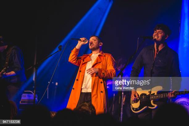 Singer Jonathan Higgs and bass player Jeremy Pritchard of the English band Everything Everything performs live on stage during a concert at the...