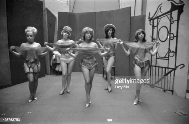 Singer Joni Adams actress Stephanie Voss and stripper Julia Verters rehearsing a burlesque routine 1964