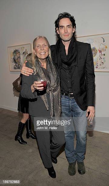 Singer Joni Mitchell and artist Alexander Yulish attend the opening for Alexander Ulish 'Interior Stories' at Gallery Brown on January 19 2013 in Los...