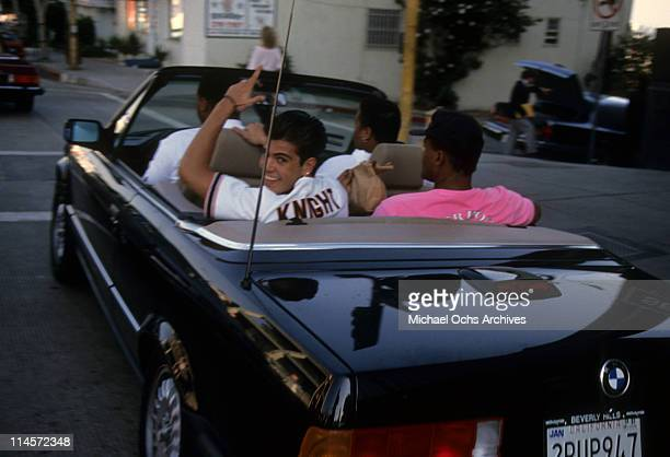 Singer Jordan Knight of New Kids On The Block gesturing while sitting in the back of a Mercedes Benz convertible circa 1990