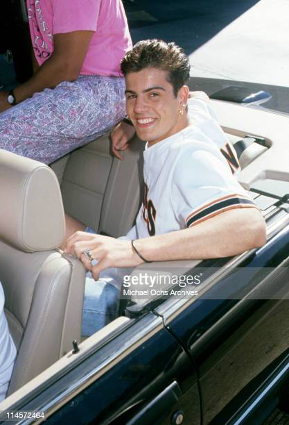 Singer Jordan Knight of New Kids On The Block sitting in the back of a convertible circa 1990