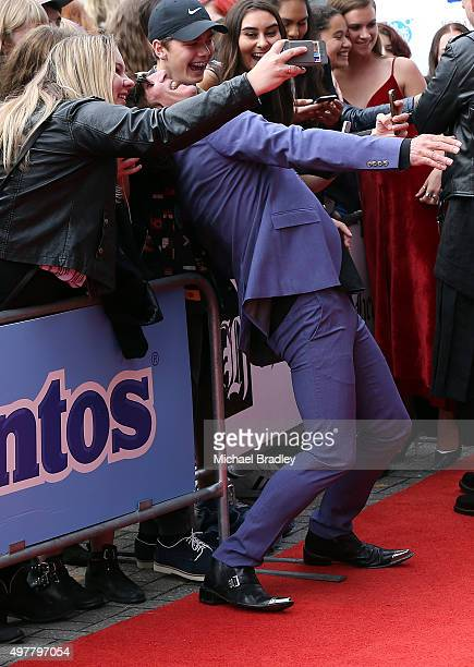 Singer Jordan Luck takes a photo with fans as he arrives at the Vodafone New Zealand Music Awards at Vector Arena on November 19 2015 in Auckland New...