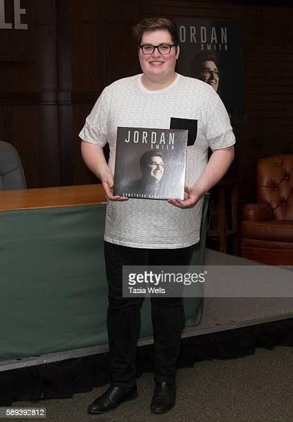 Singer Jordan Smith poses for photos with his album 'Something Beautiful' at Barnes Noble at The Grove on August 13 2016 in Los Angeles California