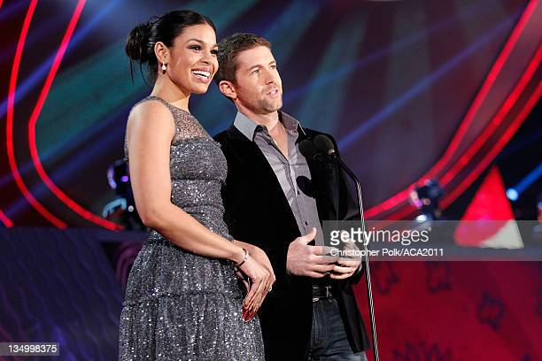 Singer Jordin Sparks and musician Josh Turner speak onstage at the American Country Awards 2011 at the MGM Grand Garden Arena on December 5 2011 in...