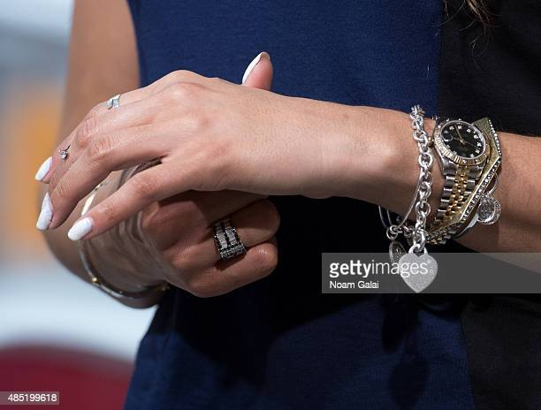 Singer Jordin Sparks jewelry detail visits 'Extra' at their New York studios at HM in Times Square on August 25 2015 in New York City