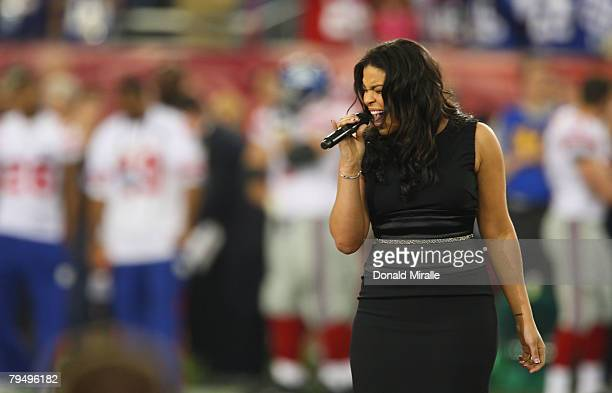 Singer Jordin Sparks performs during the pre-game show prior to the start of Super Bowl XLII between the New York Giants and the New England Patriots...