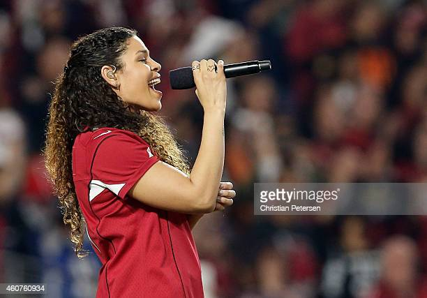 Singer Jordin Sparks performs the National Anthem before the NFL game between the Seattle Seahawks and Arizona Cardinals at the University of Phoenix...