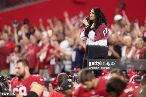 Singer Jordin Sparks performs the National Anthem before the start of the the NFL game between the Arizona Cardinals and the Dallas Cowboys at the...