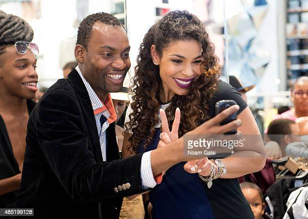 Singer Jordin Sparks poses for a selfie with a fan on the set of 'Extra' at their New York studios at HM in Times Square on August 25 2015 in New...
