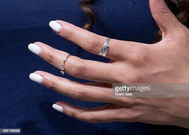 Singer Jordin Sparks ring detail visits 'Extra' at their New York studios at HM in Times Square on August 25 2015 in New York City