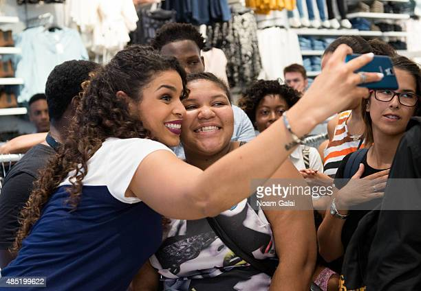 Singer Jordin Sparks takes a selfie with a fan on the set of 'Extra' at their New York studios at HM in Times Square on August 25 2015 in New York...