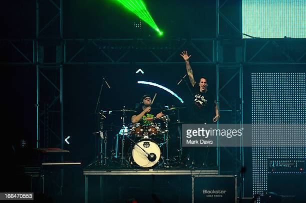 Singer Josh Friend and drummer Matthew Curtis of Modestep perform onstage during day 1 of the 2013 Coachella Valley Music Arts Festival at the Empire...