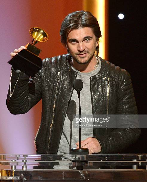 Singer Juanes accepts Best Latin Pop Album for MTV Unplugged Deluxe Edition onstage at the The 55th Annual GRAMMY Awards at Nokia Theatre on February...