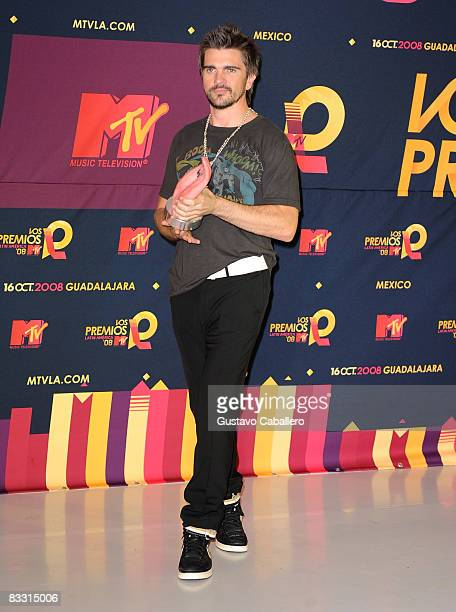 Singer Juanes poses with award in the press room during the 7th Annual 'Los Premios MTV Latin America 2008' Awards held at the Auditorio Telmex on...