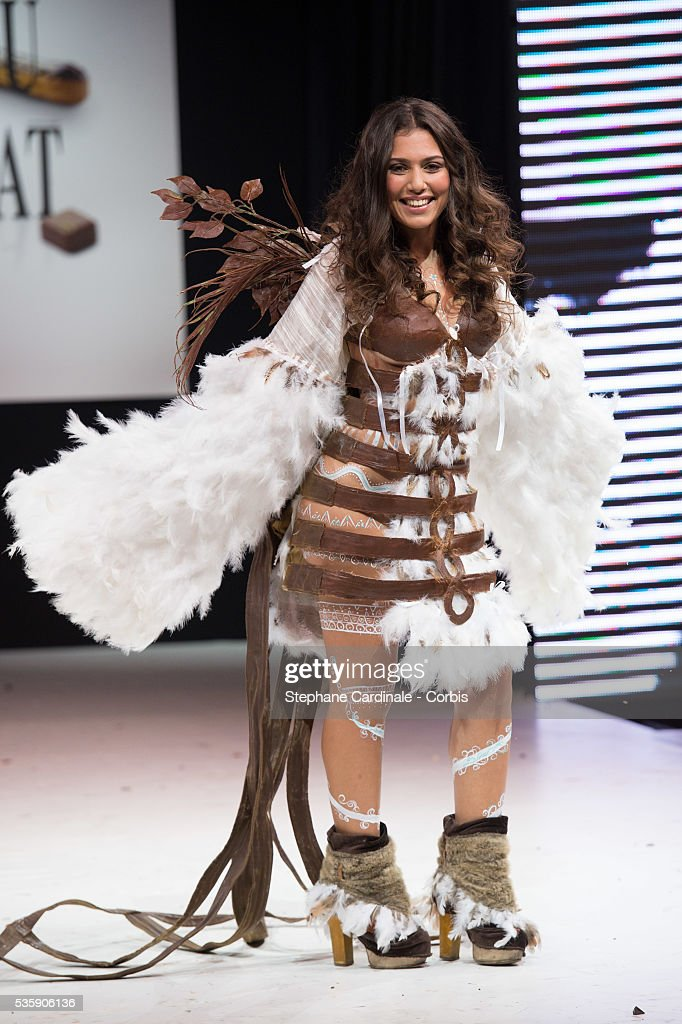 Singer Judith Hassine walks the runway and wears 'La Magicienne Itzia', a chocolate dress made by designer Valerie Pache and chocolate maker Stephane Bonnat, during the Fashion Chocolate Show at Salon du Chocolat at Porte de Versailles, in Paris.