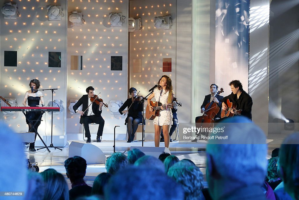 Singer Judith (3rd R) performs on stage during the recording of show host Michel Drucker's 'Vivement Dimanche' weekly show at Pavillon Gabriel on March 26, 2014 in Paris, France.