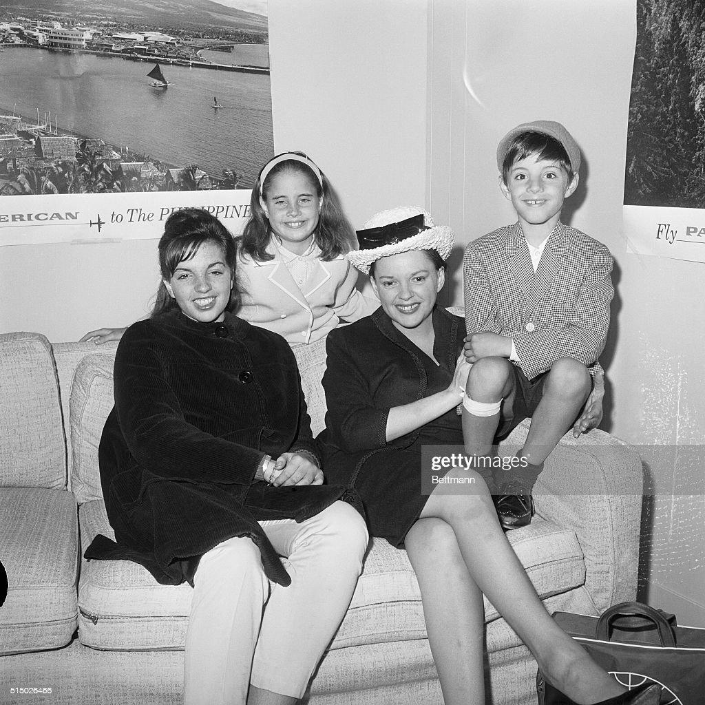 Singer Judy Garland waits with children Liza Minnelli, age