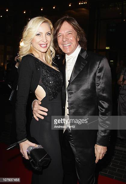 Singer Juergen Drews and his wife Ramona Drews arrive at the Berlin Press Ball 2011 at the Ullstein hall on January 8 2011 in Berlin Germany