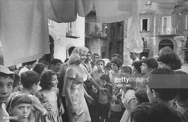 Singer Juli Reding being greeted by a group of young fans during her visit