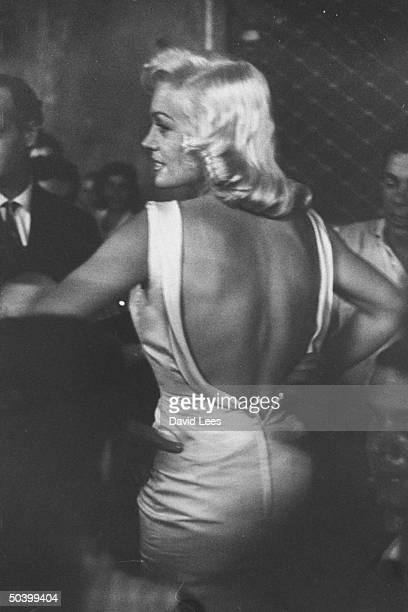 Singer Juli Reding getting her dressed hooked back