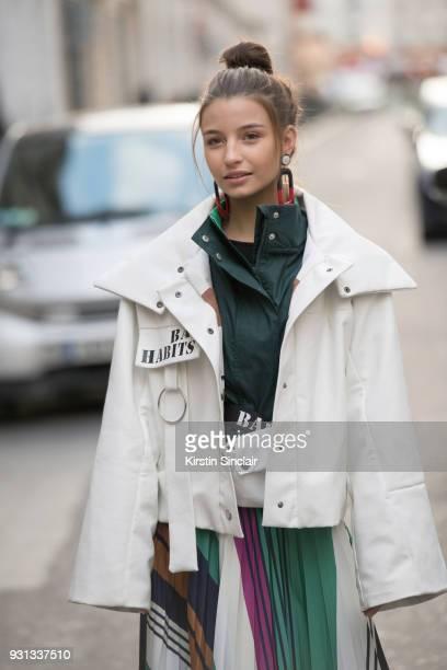 Singer Julia Wieniawa Narkiewicz wears a Fields jacket and skirt day 2 of Paris Womens Fashion Week Spring/Summer 2018, on February 27, 2018 in...