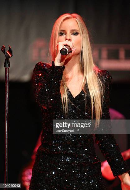 Singer Julia Williamson of the band Ace of Base performs at the amfAR Cinema Against AIDS held at The Carlu during the Toronto International Film...