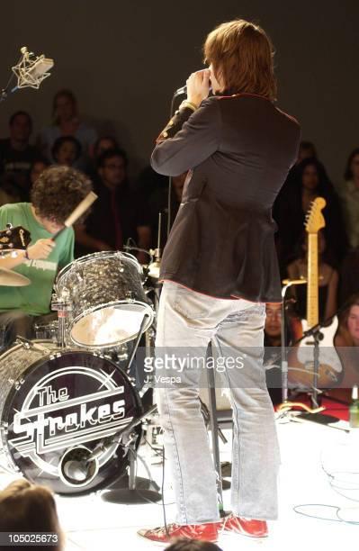 Singer Julian Casablancas drummer Fabrizio Moretti of The Strokes perform
