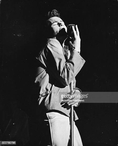 Singer 'Julian' hugging the microphone as he performs on stage a shop assistant discovered by Larry Parnes and Marty Wilde circa 1965