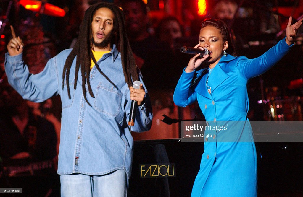 Singer Julian Marley and singer Alicia Keys perform on stage at the 'We are the Future' all-star humanitarian concert May 16, 2004 at Circus Maximus in Rome, Italy. The show is being broadcast globally on MTV and will raise money to open child centers in the most war torn regions of the world.