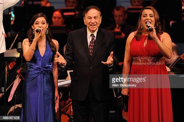Singer Juliana Hansen composer Richard Sherman singer Araceli Applegate and The Golden State Pops Orchestra perform onstage during 'A Spoonful Of...
