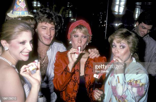 Singer Julie Budd Singer Andy Gibb and Actors Marilyn Michaels and Donna Pescow attend Maureen McGovern's Birthday Party on July 27 1982 at the...