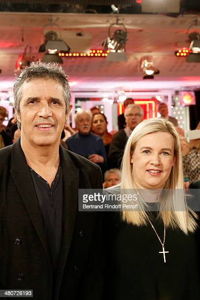 Singer Julien Clerc and awardwinning chef Helene Darroze pose during the recording of Michel Drucker's 'Vivement Dimanche' weekly show at Pavillon...
