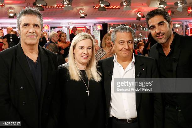 Singer Julien Clerc awardwinning chef Helene Darroze actor Christian Clavier and humorist and actor Ary Abittan pose during the recording of Michel...