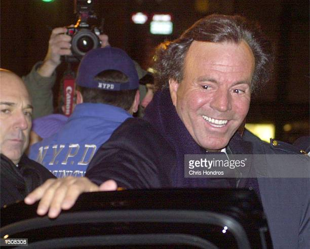 Singer Julio Iglesias leaves the wedding of Tommy Mottola and the singer Thalia, December 2, 2000 in New York City in this file photo. Iglesias''...