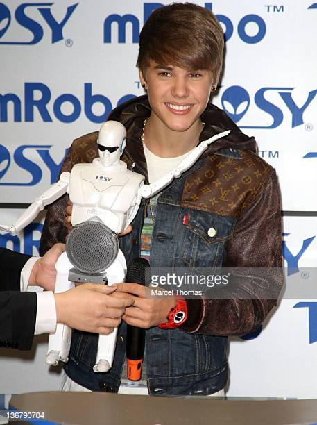 Singer Justin Beiber visits the TOSY Robotics booth at the 2012 International Consumer Electronics Show to help unveil the mROBO at Las Vegas...