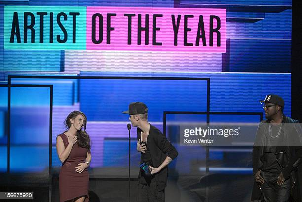 Singer Justin Bieber accepts the award for Artist of the Year with Pattie Malette and william onstage during the 40th American Music Awards held at...